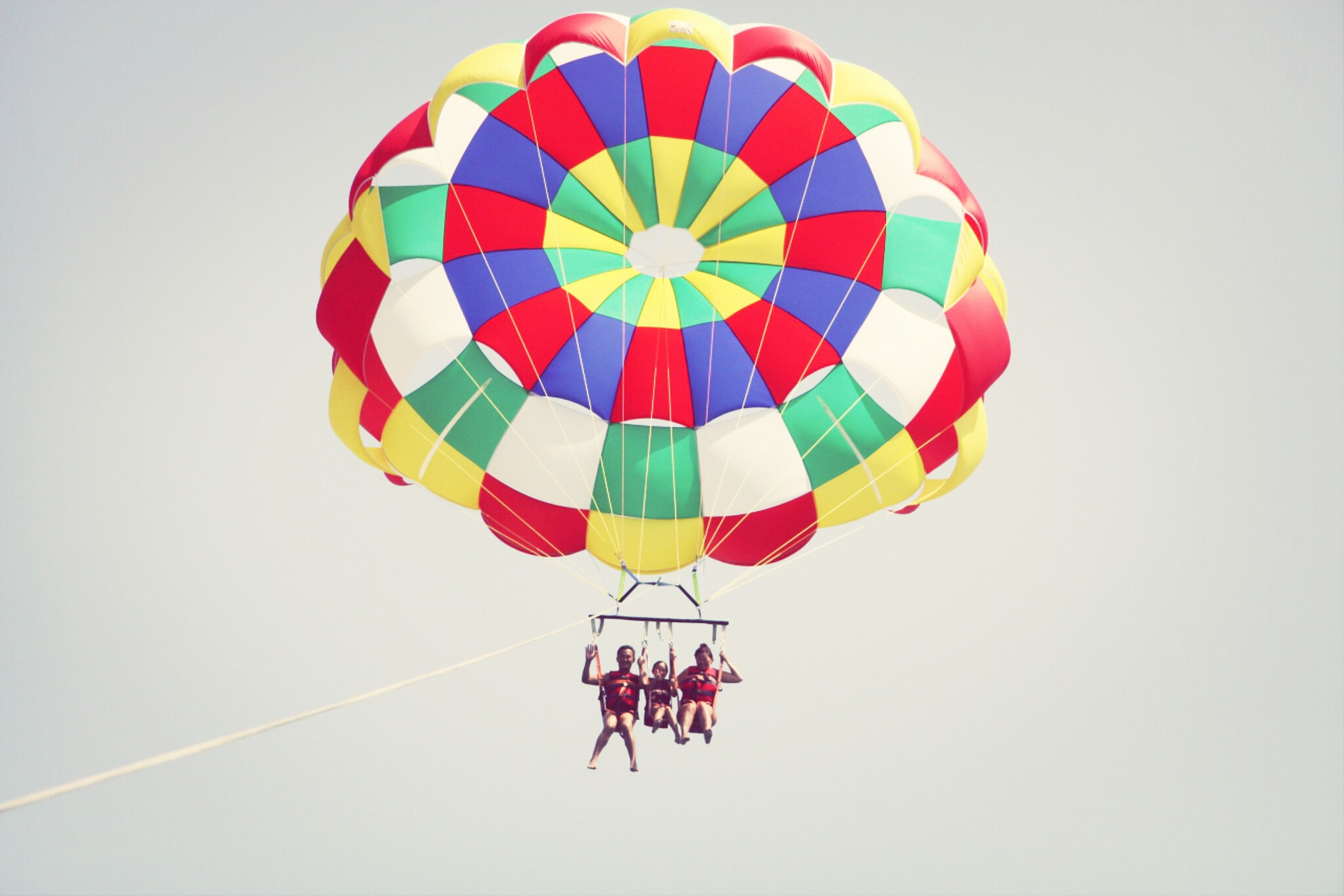 multi colored, low angle view, hot air balloon, mid-air, copy space, colorful, art, art and craft, flying, clear sky, creativity, decoration, pattern, balloon, celebration, parachute, hanging, no people, umbrella, shape