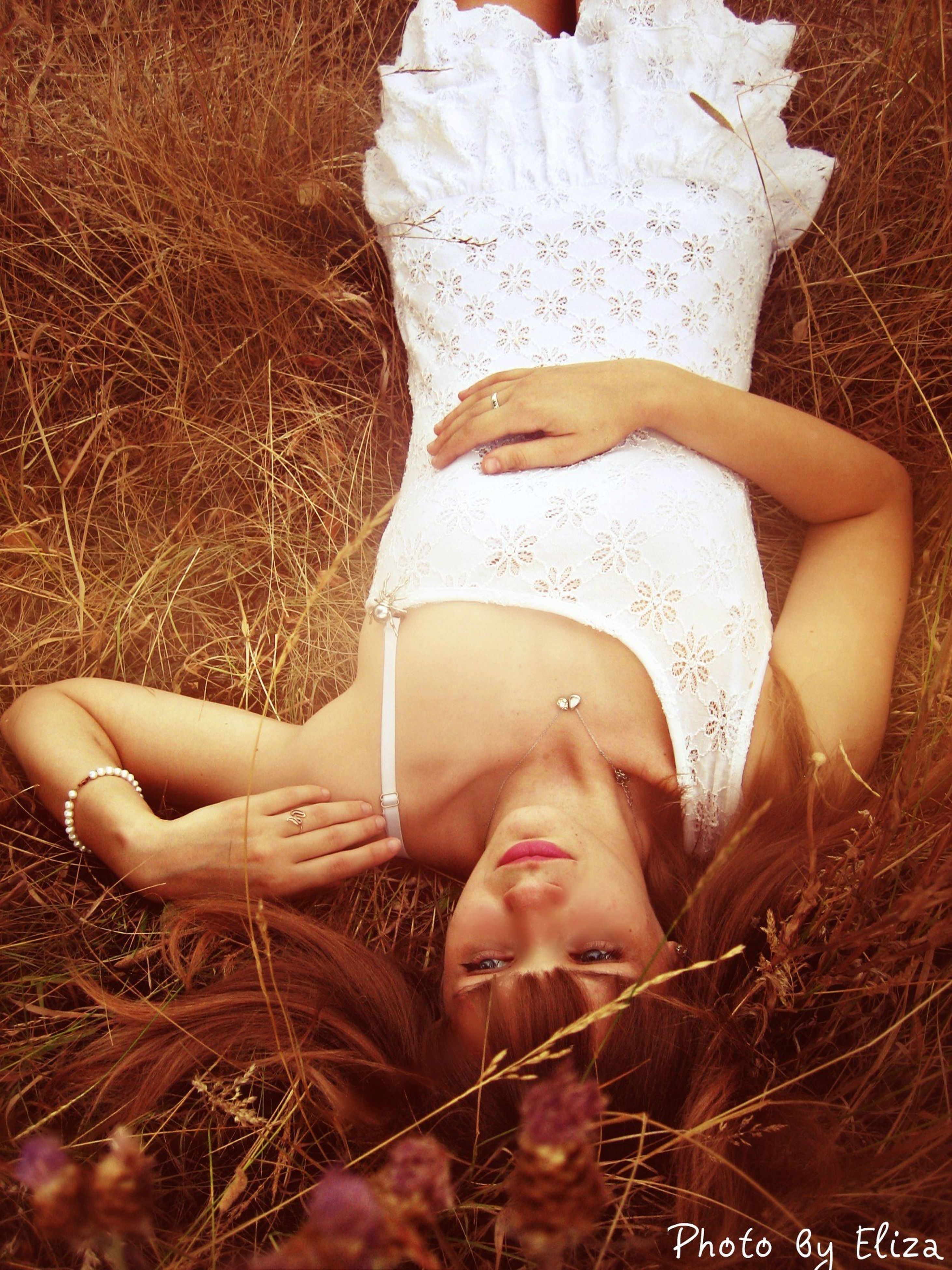 young adult, young women, lifestyles, person, leisure activity, looking at camera, portrait, relaxation, lying down, eyes closed, field, long hair, grass, sitting, front view, casual clothing, smiling