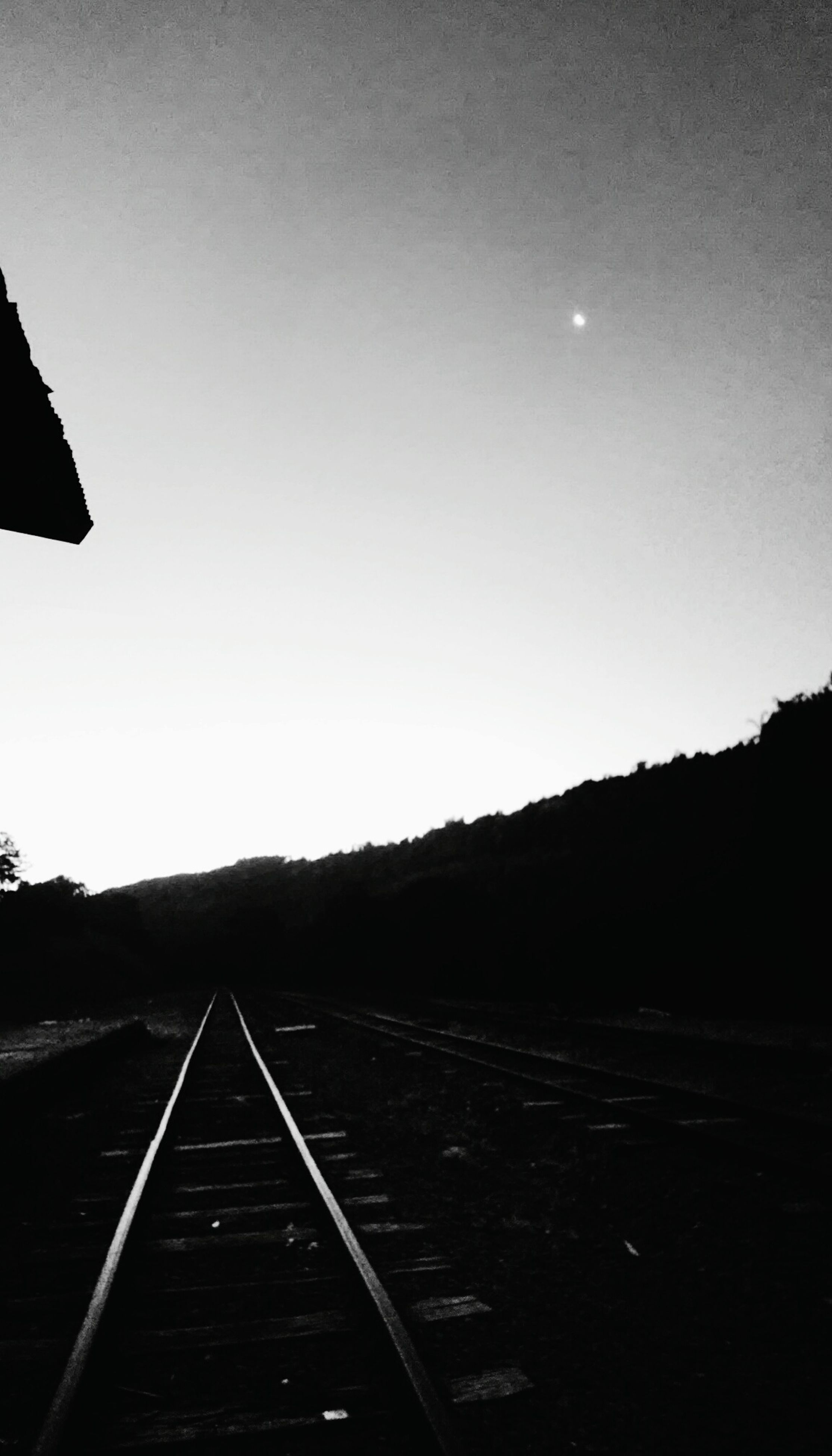 clear sky, the way forward, copy space, transportation, railroad track, mountain, diminishing perspective, vanishing point, tranquility, tranquil scene, road, landscape, sky, nature, rail transportation, scenics, outdoors, empty, long, mountain range