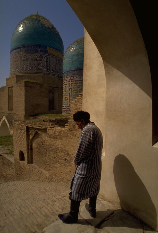 Old man in contemplation by the Domes at the Avenue of Mausoleums (Shah-i-Zinda) in Samarkand, Uzbekistan; one of the oldest inhabited cities in Central Asia, along with Bukhara. An Islamic centre for scholarly study, Samarkand prospered from its position on the Old Silk Road; described in 'The Travels of Marco Polo' as 'a very large and splendid city'. UNESCO added the city to its World Heritage List, in 2001; as Samarkand - Crossroads of Cultures. http://pics.travelnotes.org Architecture Avenue Of Mausoleums Blue Blue Sky Dome Full Length Historical Building History Islam Islamic Architecture Landmarks Michel Guntern Samarkand People And Places Silk Road Street Photography Tourism Travel Travel Destinations Travel Photography Travel Photos Travel Pics Up Close Street Photography Uzbekistan World Heritage