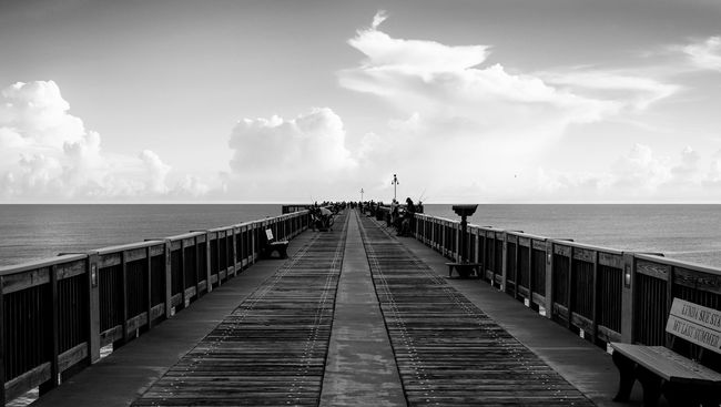 Pier diminishing into the ocean and cloudy sky. Balance Beauty In Nature Cloud - Sky Clouds Coast Copy Space Day Diminishing Perspective Horizon Over Water Idyllic Nature Ocean Open Space Pier Sea Sea And Sky Sky Symmetry The Way Forward Tourism Tranquil Scene Tranquility Travel Destinations Vacations Water