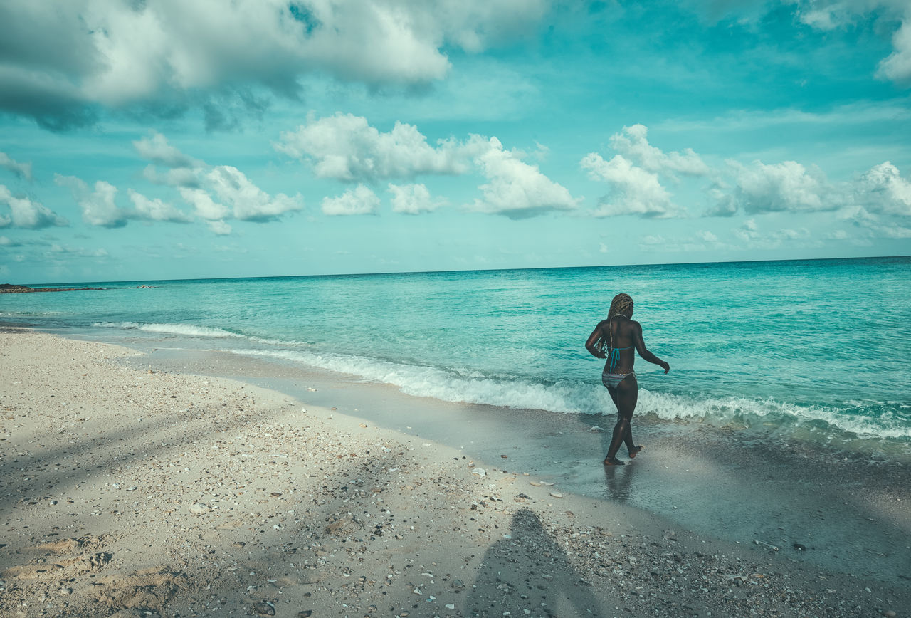 Early Swim Beach Beauty In Nature Bikini Bimini Cloud - Sky Day Full Length Horizon Over Water Leisure Activity Lifestyles Nature One Person Outdoors People Photographyisthemuse Real People Sand Scenics Sea Shore Sky The Bahamas Turquoise Water Water Young Adult