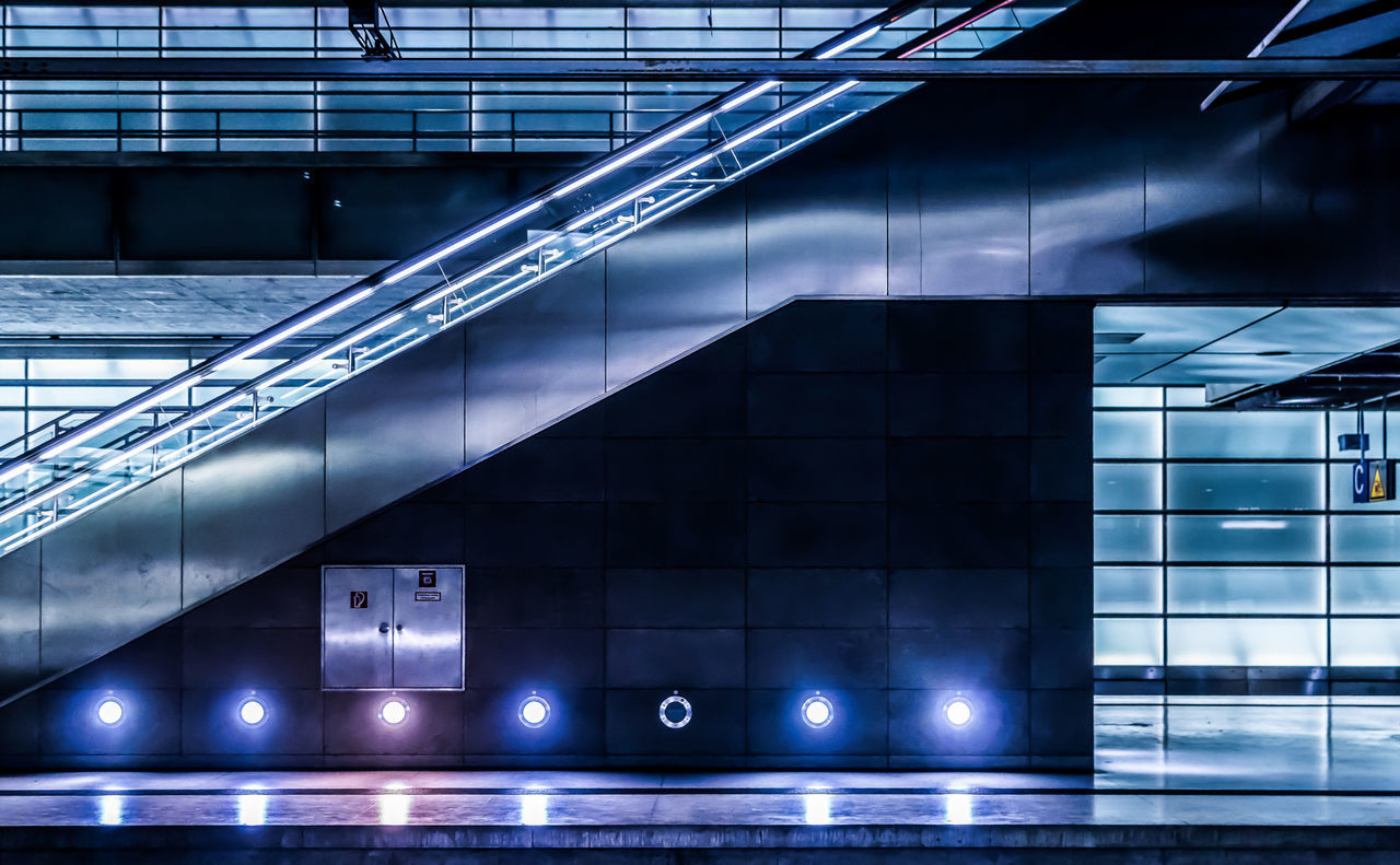Futuristic Modern Modern Architecture Station Architecture Building Exterior Built Structure City Electric Light Escalator Illuminated Indoors  Modern Neon Life Neon Lights Night No People Platform