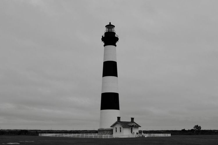 Bodie Island Architecture Sky Built Structure Lighthouse Direction Travel Destinations Low Angle View Outdoors Statue Building Exterior No People Day Lighthouse OBX Light Nautical