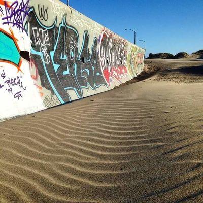 Graffiti Art Beach Day Desert Nature No People Ocean Beach Outdoors Sand Sand Dune Skater Sky Urban Art Vandalism