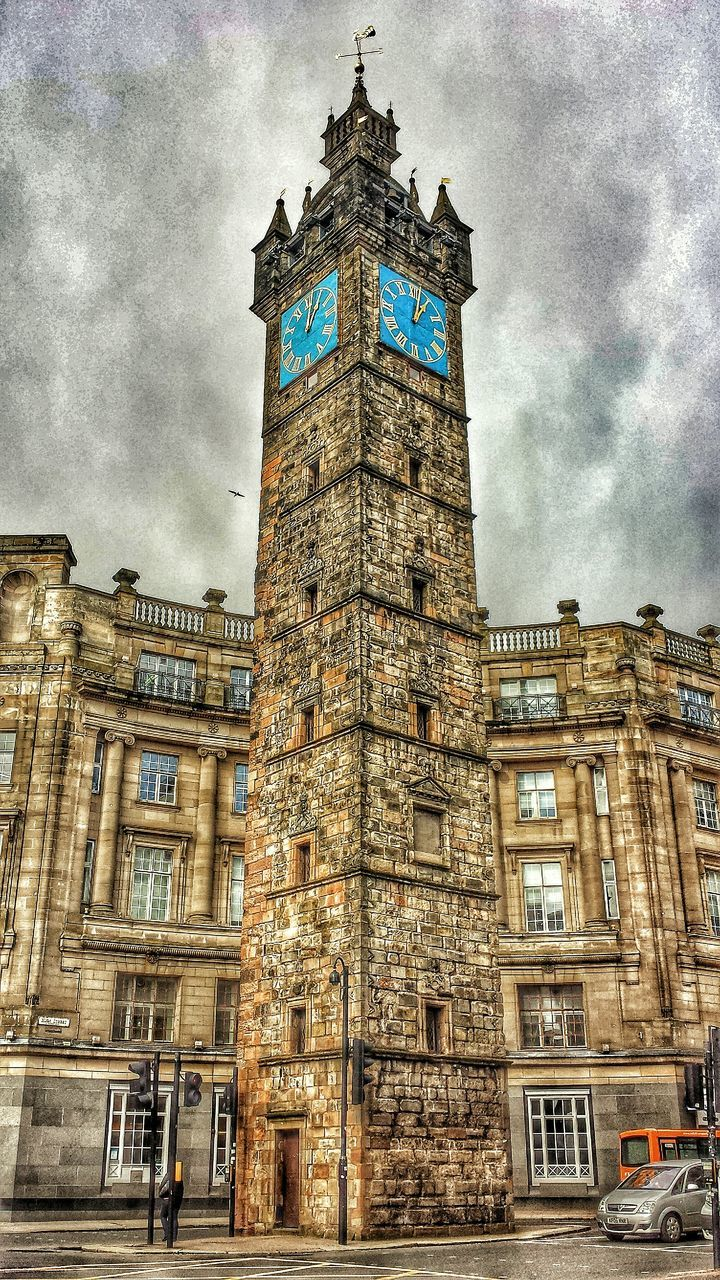 architecture, clock tower, building exterior, tower, sky, built structure, city, travel destinations, cloud - sky, low angle view, no people, outdoors, day, clock