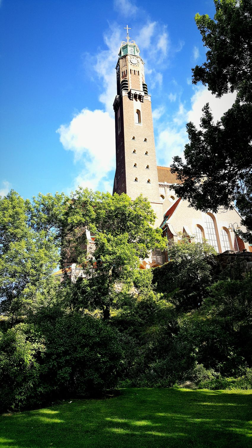 Stockholm Clock Tower Cloud - Sky Sky History Building Exterior Church Church Tower Grass Clouds Day Outdoors No People Old-fashioned Architecture Summer Built Structure Trees Brick Church Brick Building
