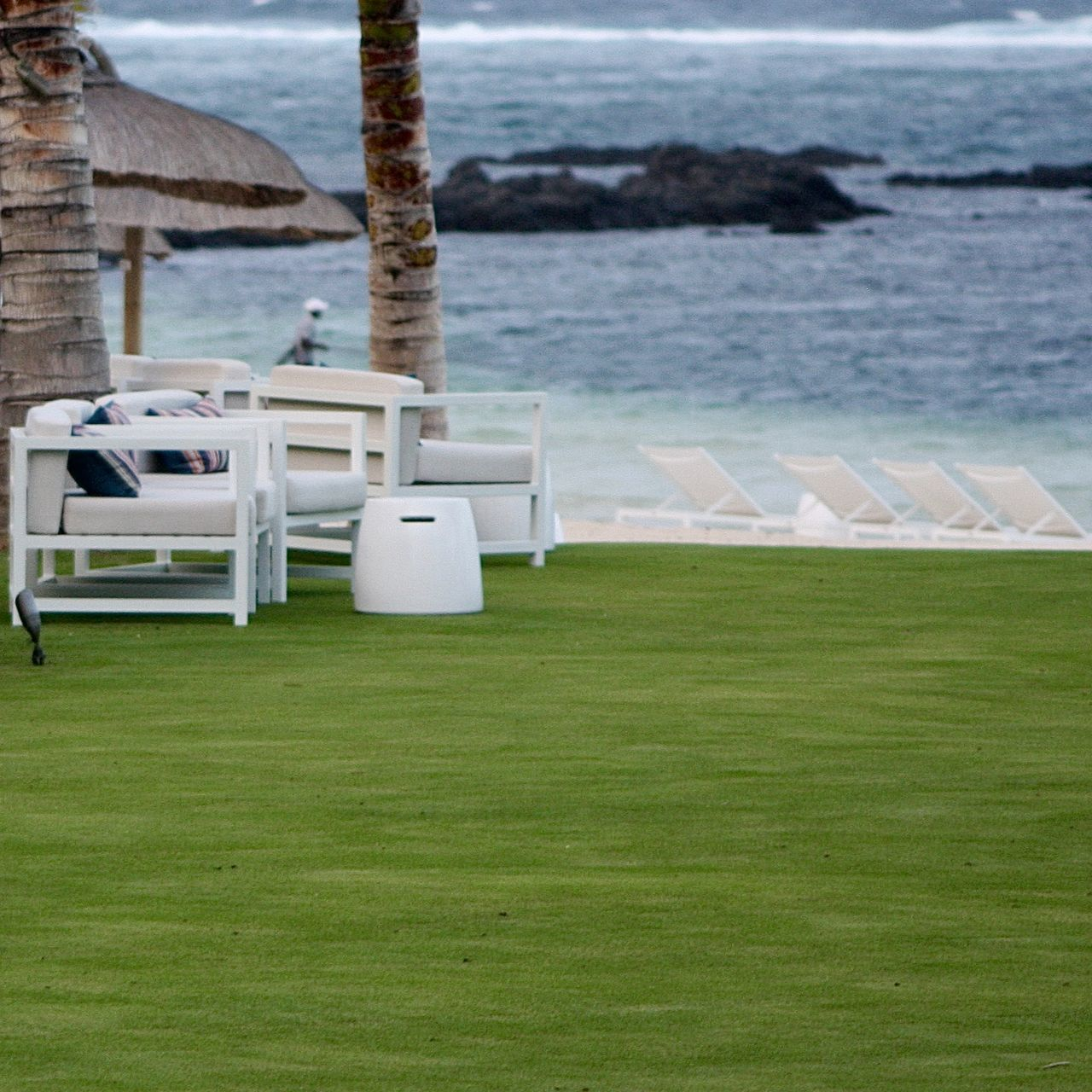 Beach Chairs Close-up Exterior Gardening Grass Green Greenery Holiday Lawn Mauritius Nature Ocean Outdoors Pantone Colors By GIZMON Personal Perspective Relaxing Rocks Sea Sunbeds Take Your Place Water Wave White
