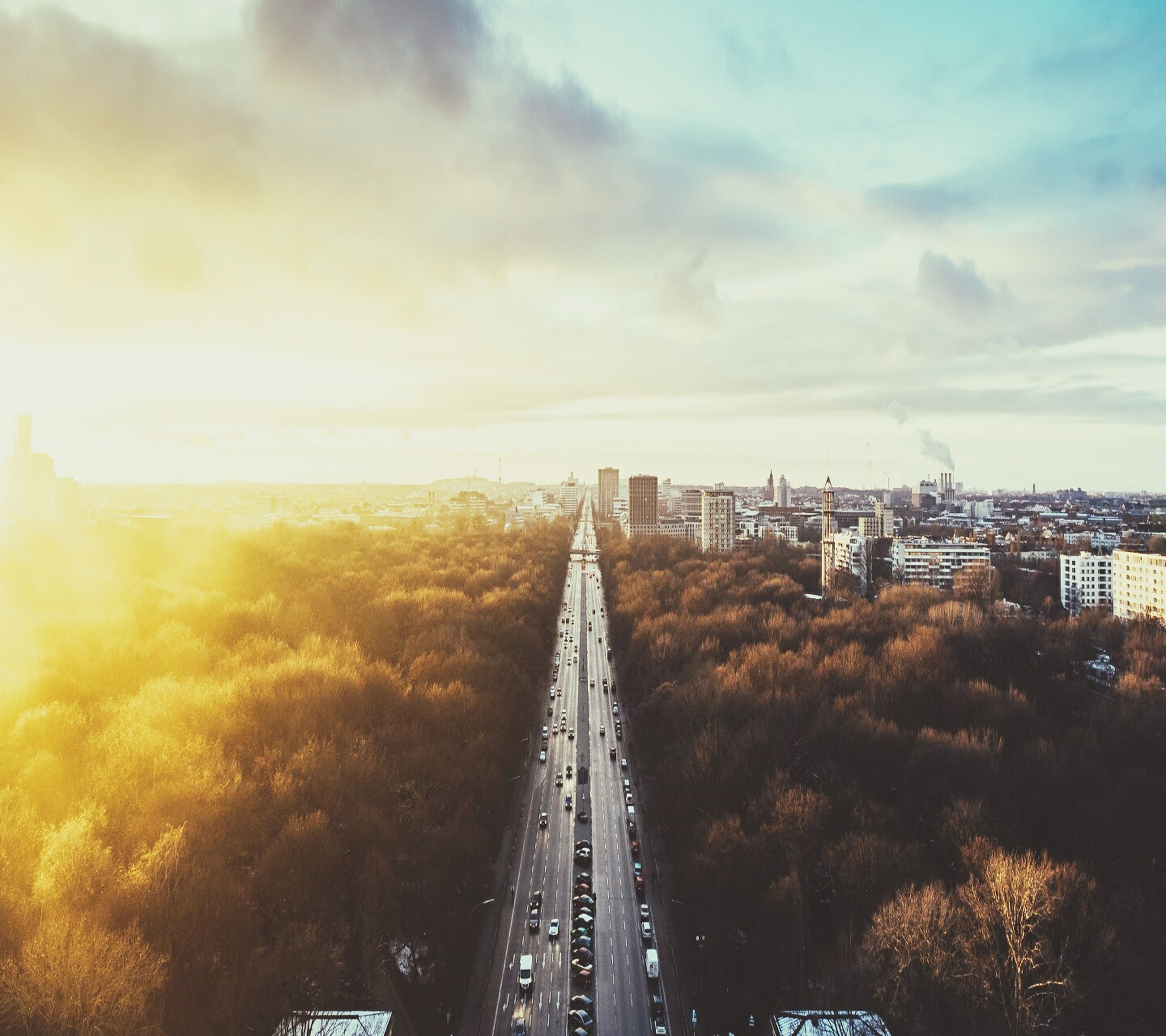 transportation, high angle view, mode of transport, sky, tree, city, land vehicle, cloud, cityscape, day, cloud - sky, diminishing perspective, no people, aerial view, the way forward