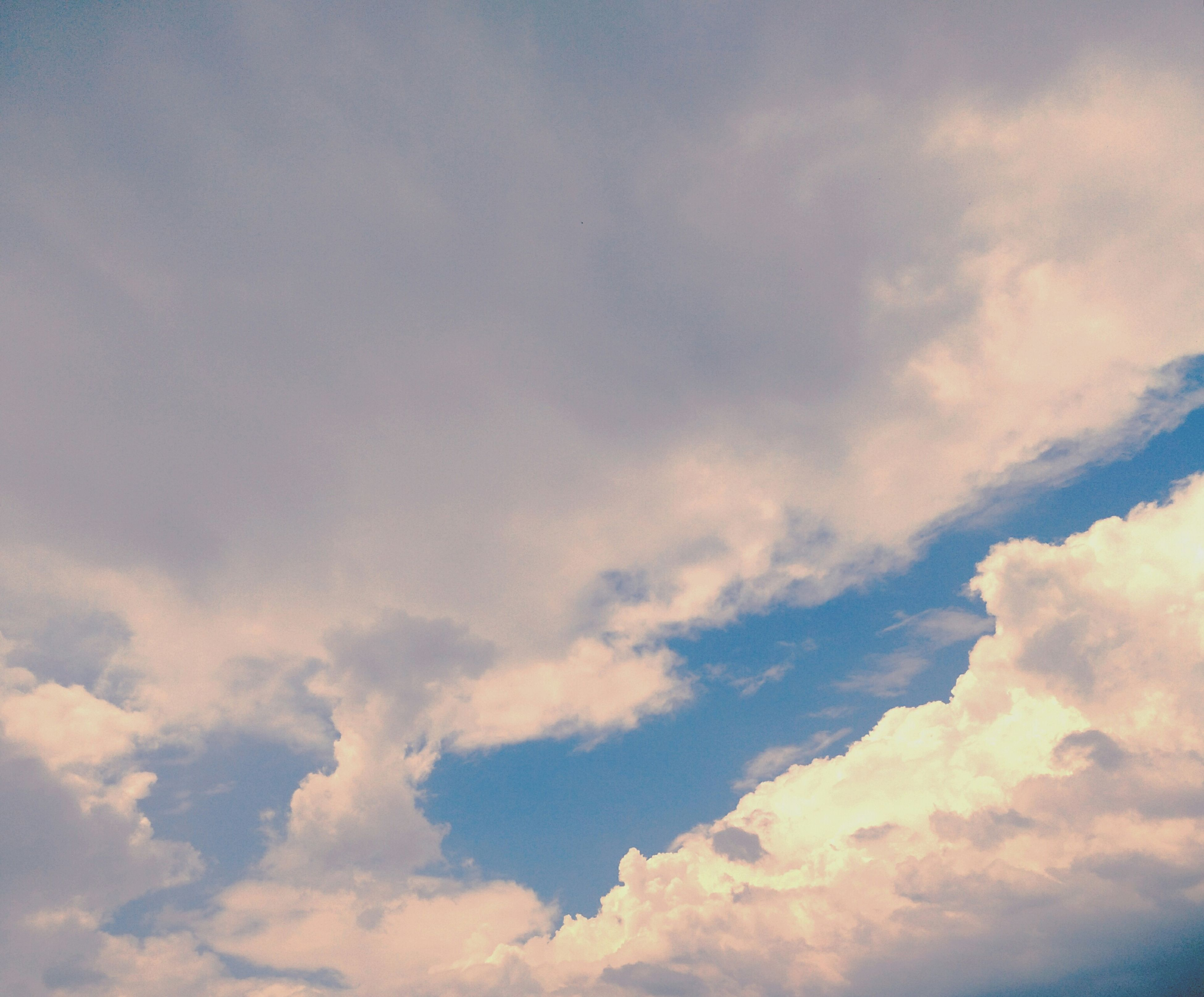 sky, cloud - sky, sky only, low angle view, beauty in nature, tranquility, scenics, cloudy, tranquil scene, nature, backgrounds, cloudscape, full frame, cloud, idyllic, white color, blue, outdoors, weather, no people