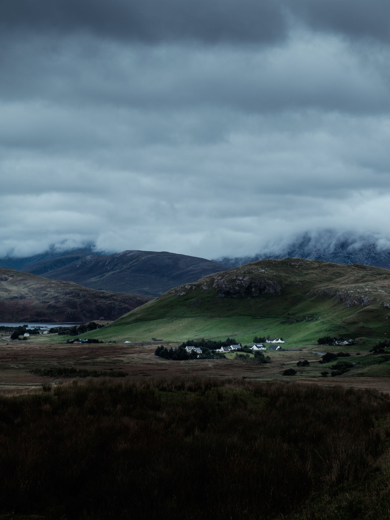Thank you so much for your support during this year! I was on several trips but scotland was definitely my favorite. So let's look back to a typical cloudy day in the Scottish Highlands. Location: Highlands, Scotland Equipment: Fujifilm X-T1 + XF18-55 Agriculture Bad Weather Beauty In Nature Cloud - Sky Clouds Dramatic Sky Green Hill Home Houses Landscape Lush Foliage Mood Moody Mountain Nature Outdoors Rural Scene Schottland Scotland Small Town Storm Thunderstorm Tranquility Tree