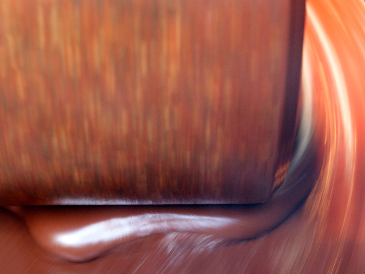 Close-up of chocolate in machine Abstract Backgrounds Brown BURR Chocolate Chocolate Machine Detail Full Frame Grindstone Ideas Indoors  Motion Pattern Production Process Shiny Sweet Textile Textured