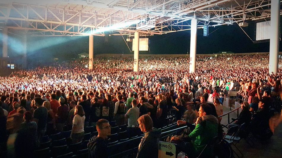 Blink182 Large Group Of People Illuminated Crowd Night Standing Celebration Lighting Equipment Person City Togetherness Stadium Spectator City Life Outdoors Performance Electric Light