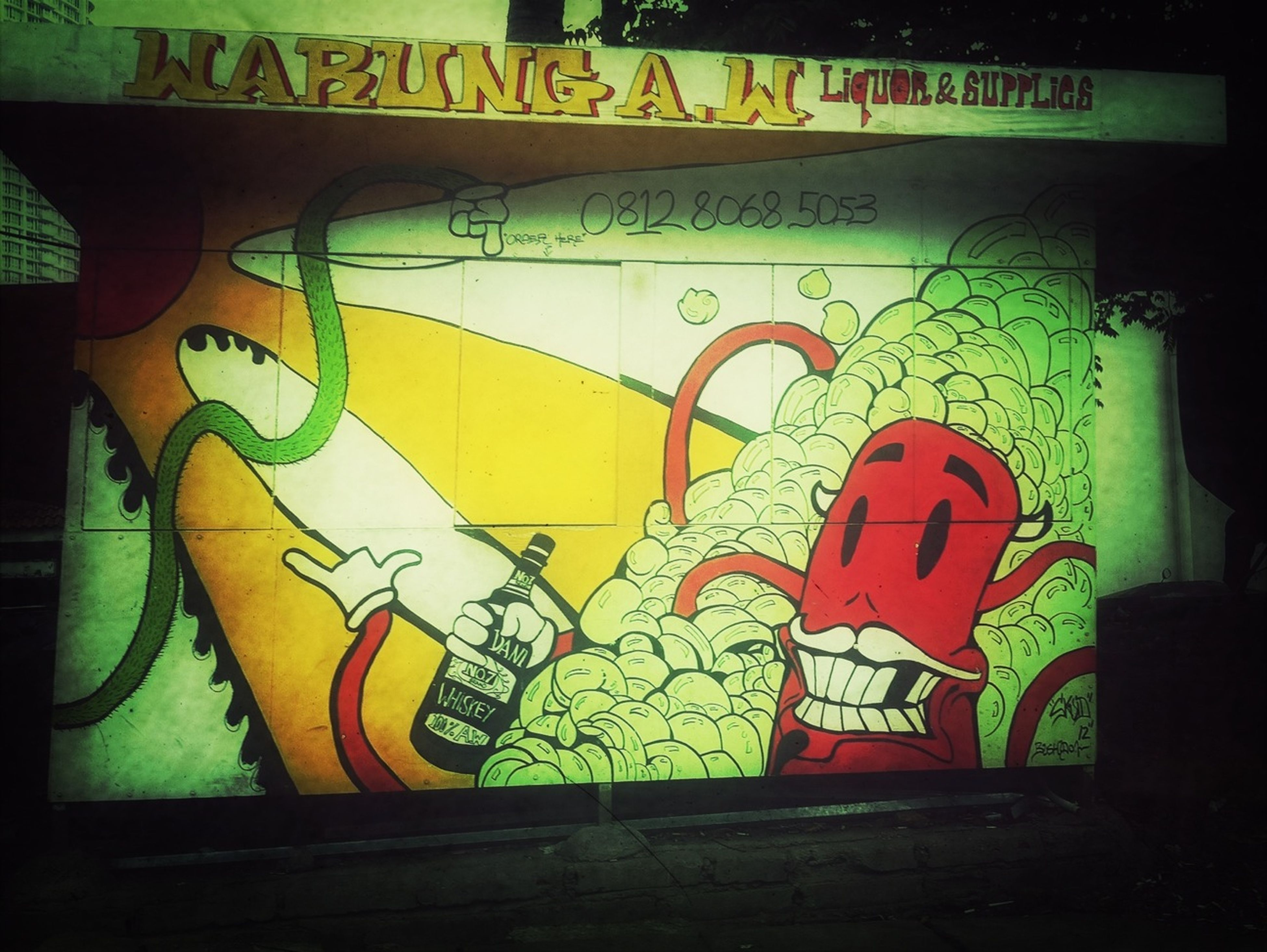 graffiti, art, creativity, art and craft, wall - building feature, multi colored, text, indoors, human representation, built structure, western script, street art, yellow, wall, architecture, design, communication, no people, pattern, illuminated
