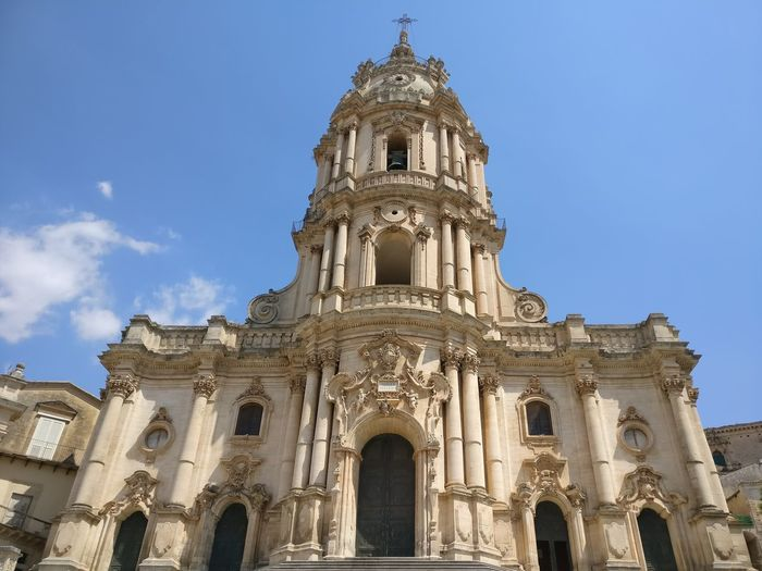 Modica Architecture Religion History Travel Destinations Building Exterior Low Angle View Spirituality City Cloud - Sky Day Outdoors No People Place Of Worship Blue Sky Built Structure