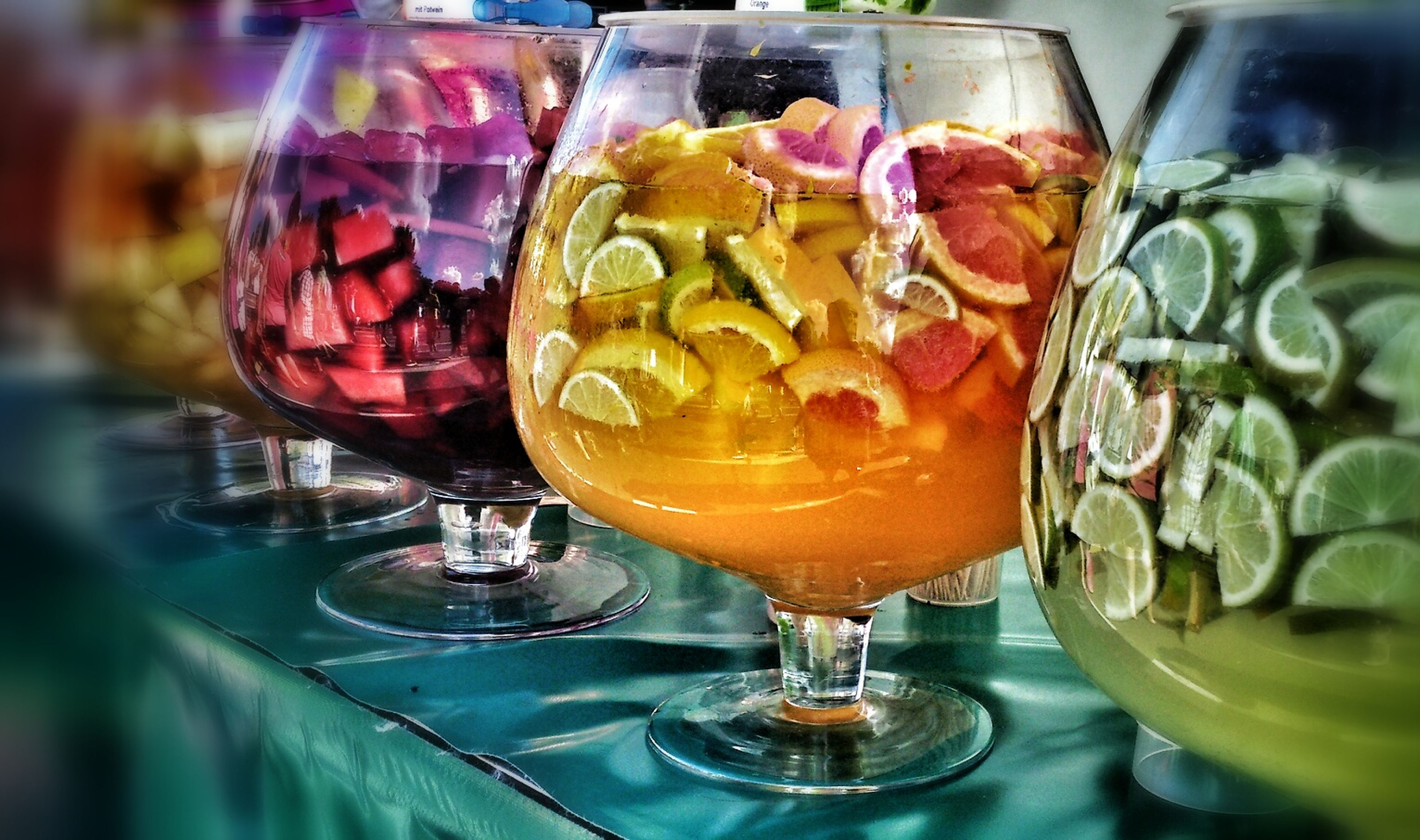 food and drink, drinking glass, drink, freshness, refreshment, indoors, glass - material, table, still life, alcohol, close-up, transparent, wineglass, cocktail, restaurant, wine, focus on foreground, glass, indulgence, food