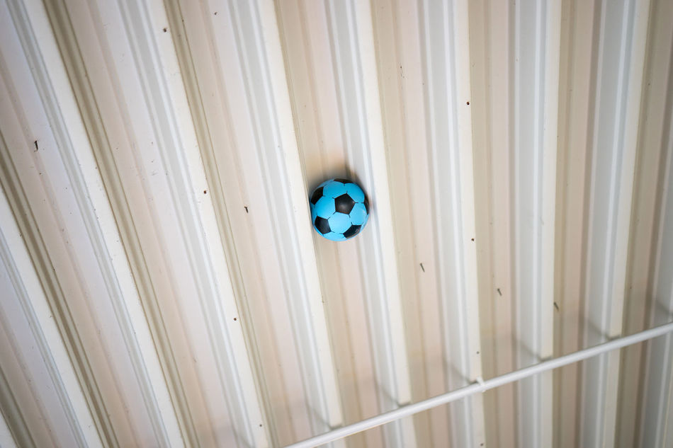 Alone Anthropomorphic Face Ball Between Blue Can Not Reach Day Football Forget Forgotten Indoors  No People Round Staying Alone Stick Stuck Stuck Inside Succer