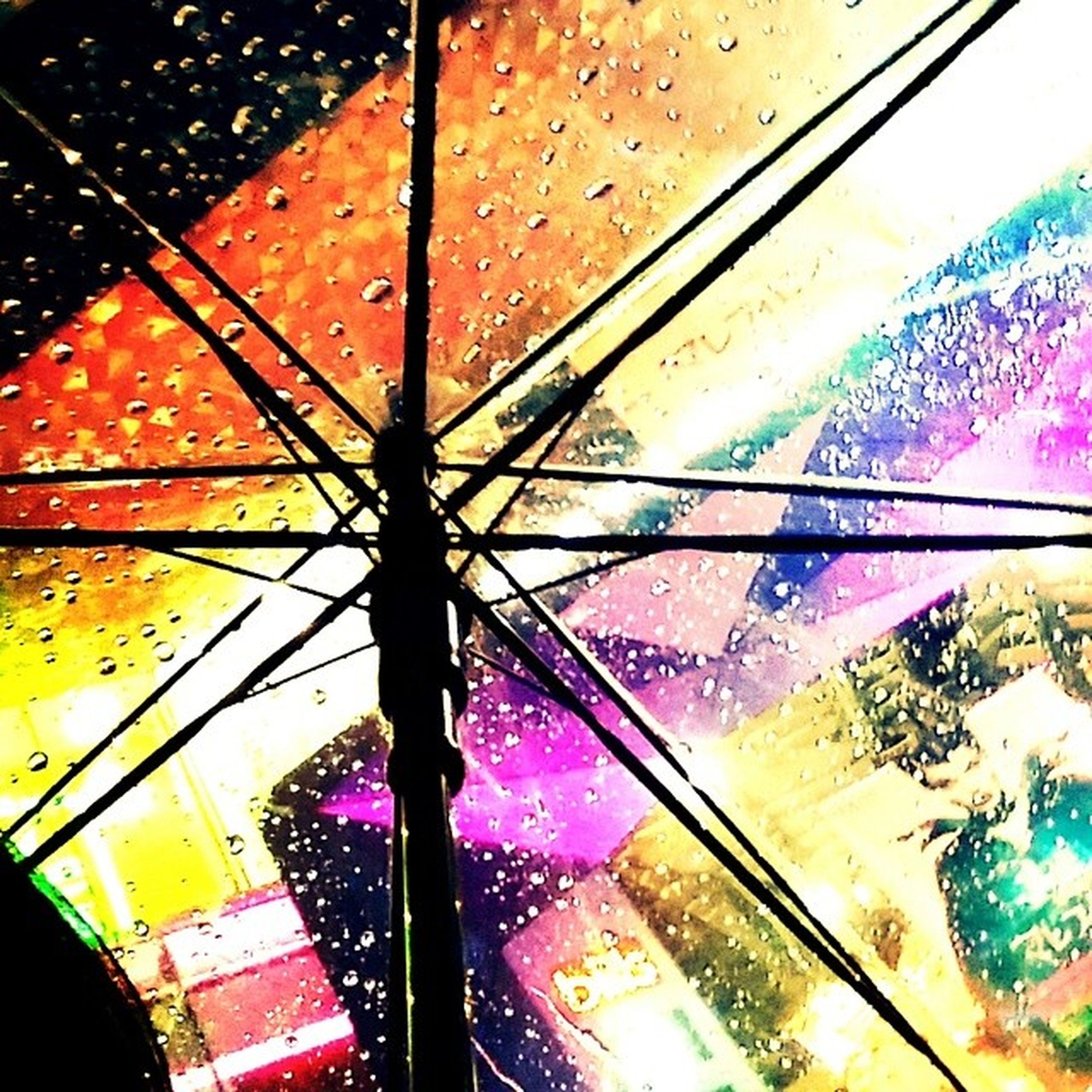 umbrella, glass - material, reflection, multi colored, window, transparent, close-up, built structure, architecture, wet, transportation, rain, day, part of, water, indoors, street, sky, no people