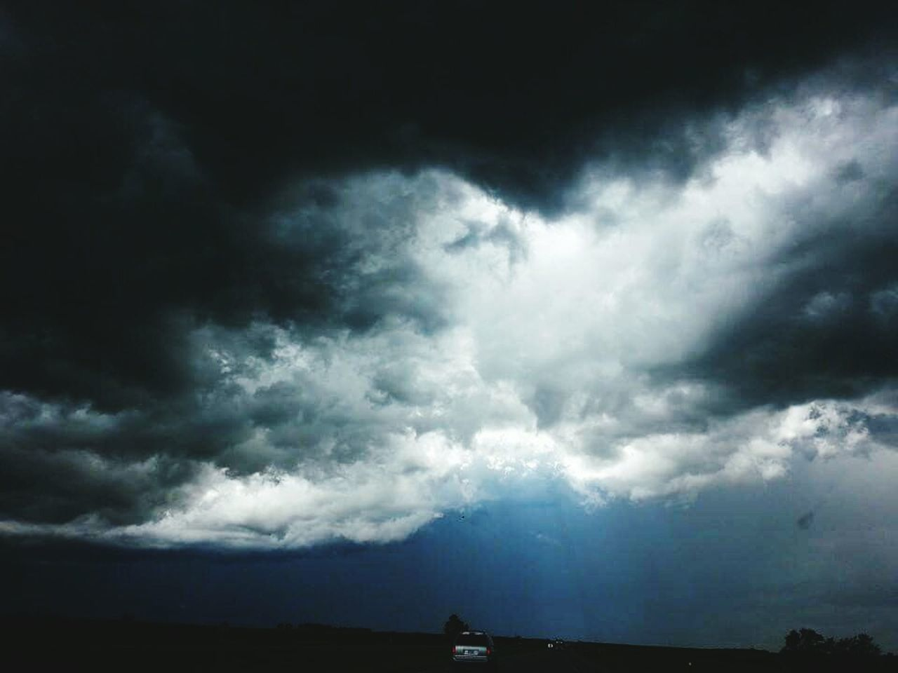 cloud - sky, dramatic sky, sky, cloudscape, thunderstorm, weather, storm cloud, storm, silhouette, nature, outdoors, scenics, no people, built structure, building exterior, beauty in nature, architecture, day
