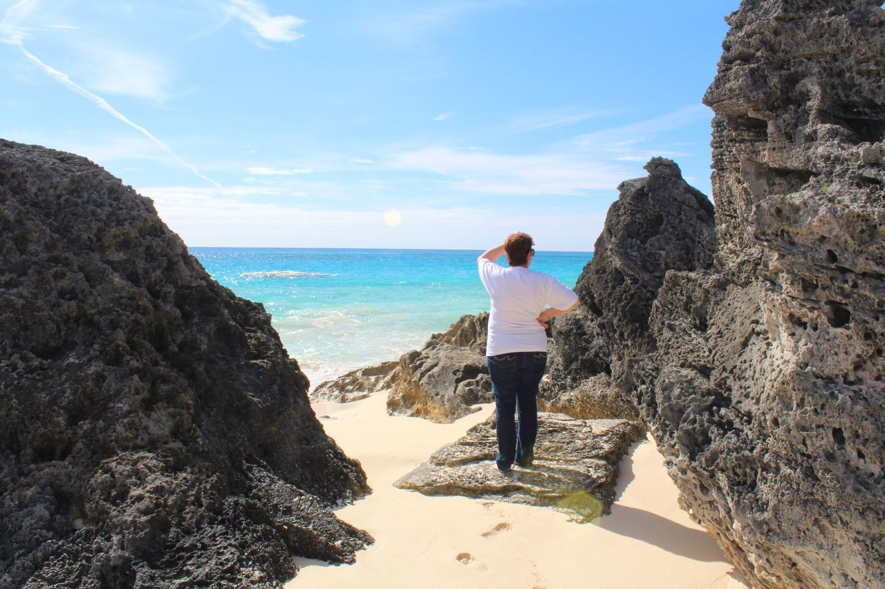 Lost In Paradise Bermuda Bermuda Triangle Lost In Paradise Sea Full Length Rock - Object Beauty In Nature Real People Scenics Water Sky Leisure Activity Lifestyles Horizon Over Water One Person Beach Outdoors Nature Tranquil Scene Day Rear View Standing Tranquility
