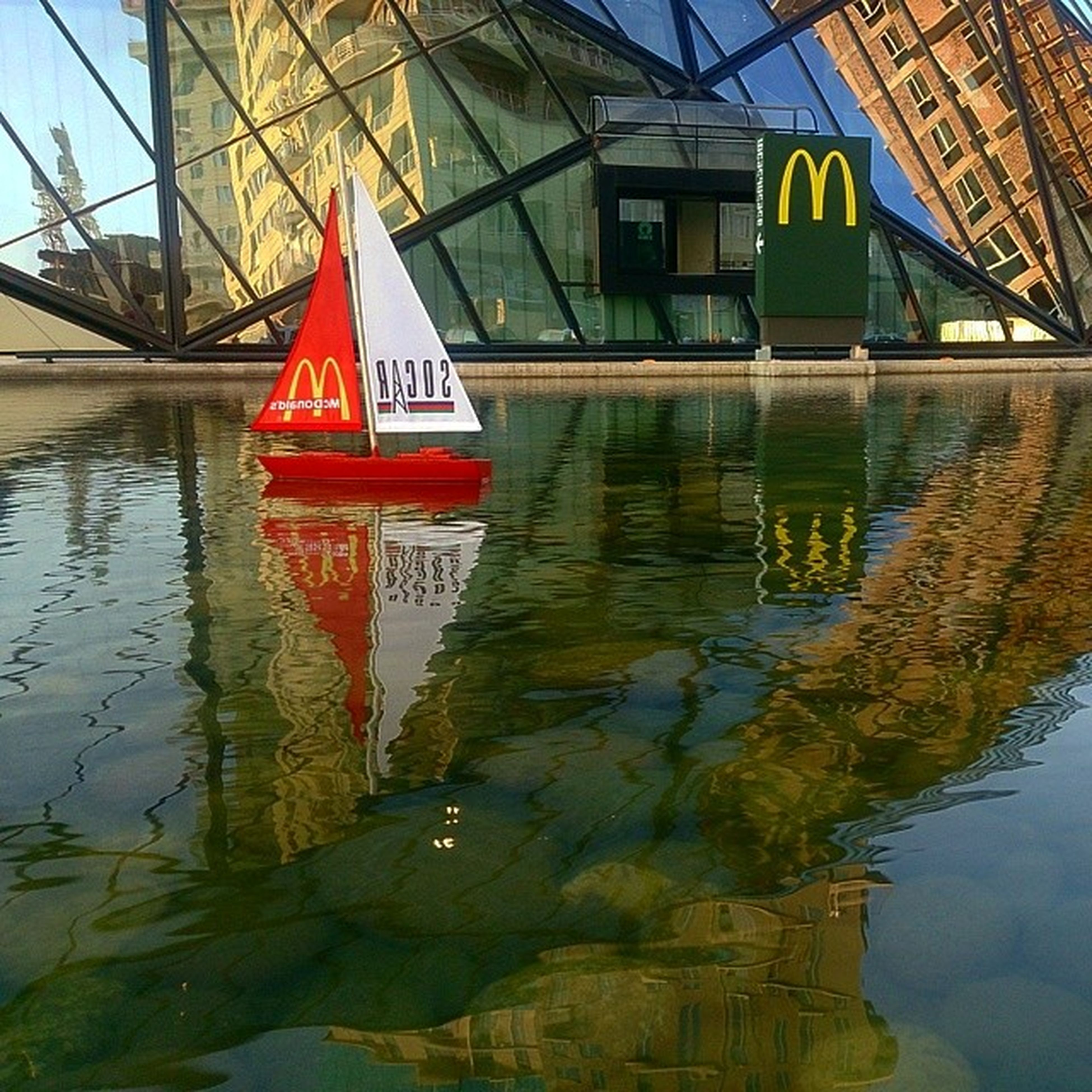 water, reflection, architecture, built structure, transportation, nautical vessel, waterfront, building exterior, boat, mode of transport, canal, moored, river, lake, day, outdoors, rippled, no people, connection, bridge - man made structure