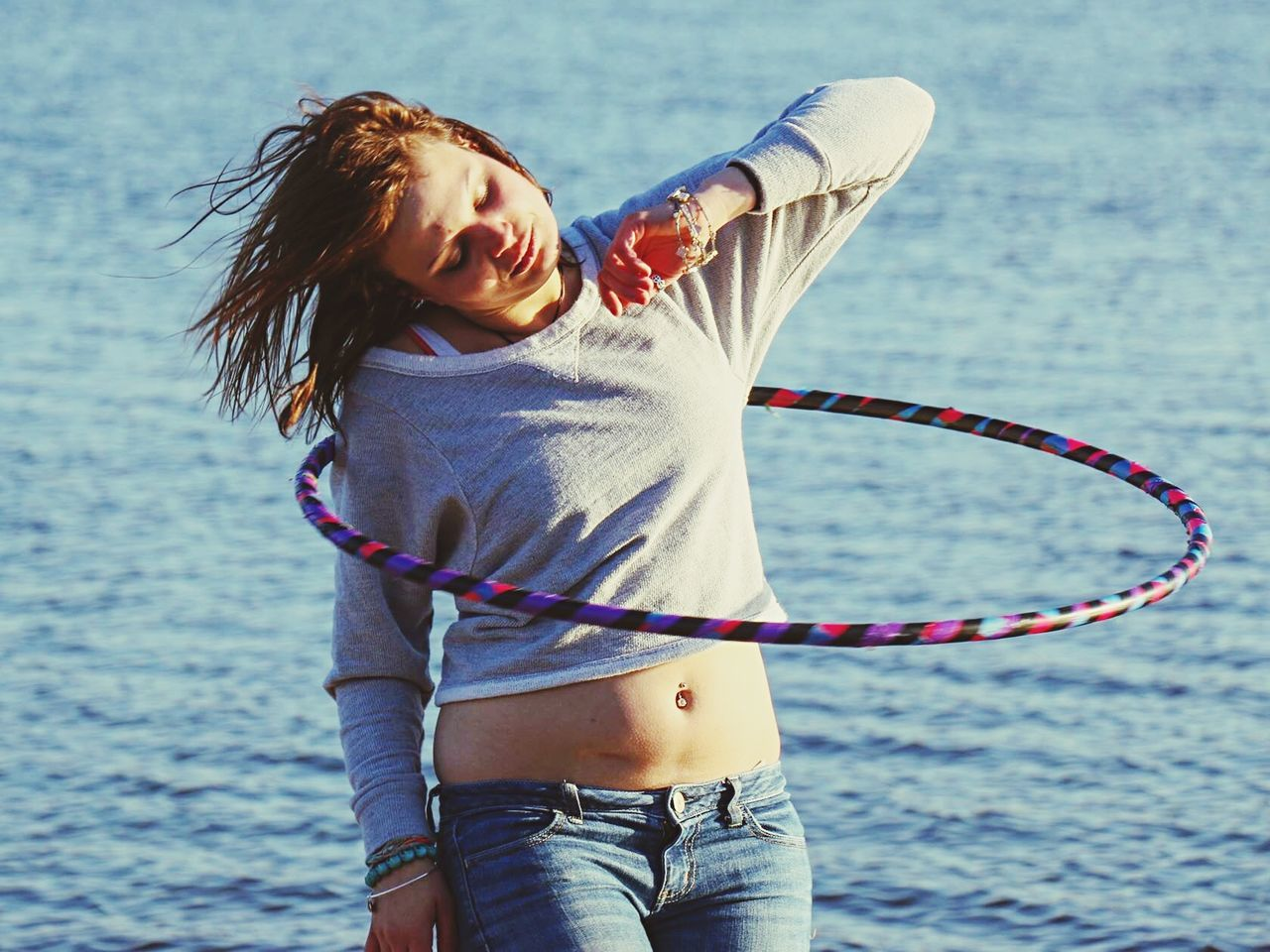 Doylestown Peace Valley Grateful Hula Hooping  Water Real People Three Quarter Length Fun Motion Leisure Activity Sea One Person Lifestyles Happiness Young Women Outdoors Smiling EyeEmNewHere EyeEm Ready   EyeEmNewHere