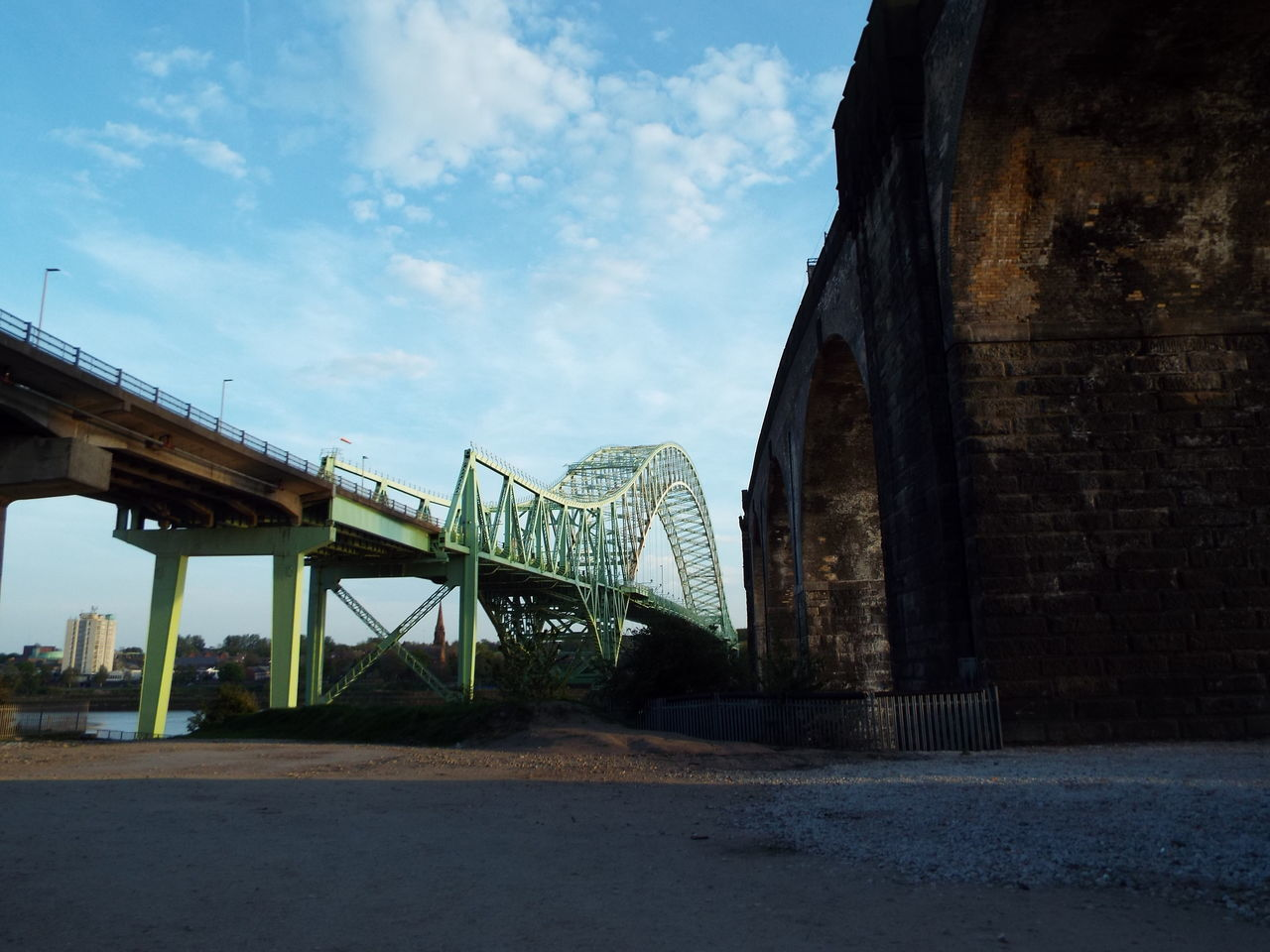 The Silver Jubilee Bridge (or otherwise known as Runcorn Bridge) on the left which allows cars etc to travel between Widnes and Runcorn. The bridge on the right is the Runcorn Railway Bridge (also known as Ethelfleda Bridge and Britannia Bridge) Runcorn Bridge Bridge River Mersey River Water Riverbank Viaduct Runcorn Railway Bridge Ethelfleda Bridge Britannia Bridge Widnes Runcorn The Architect - 2016 EyeEm Awards