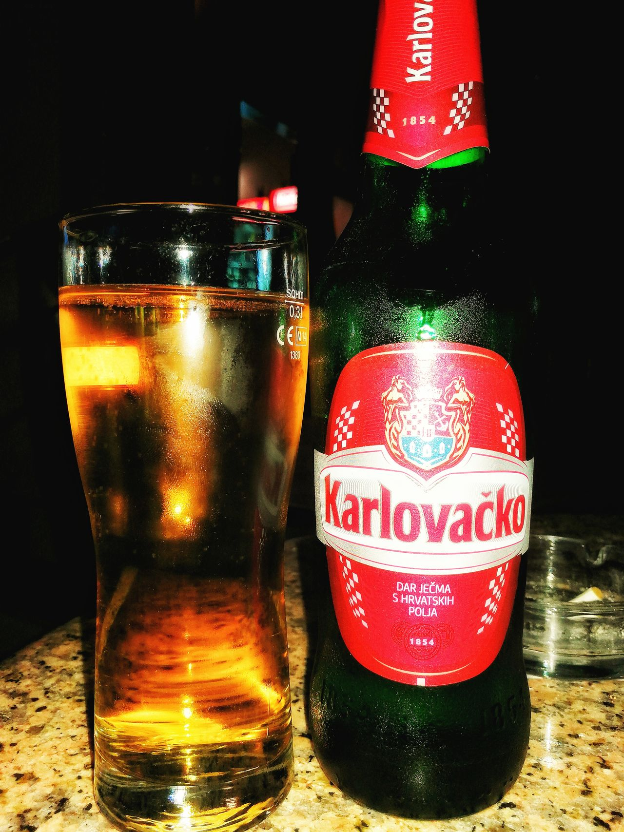 I'll have a cold one Drink Alcohol Drinking Glass Bottle Freshness Beer Karlovacko