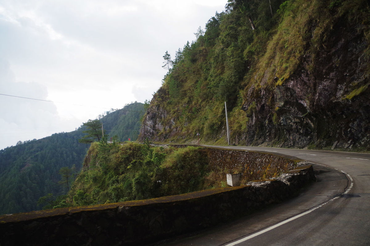 Rich in unforgiving curves, Halsema Highway is known as one of the most dangerous highways in Asia. Altitude ASIA Beauty In Nature Cold Temperature Day High Highlands Highway Igorot Landscape Morning Mountain Nature Nature No People Outdoors Philippines Road Road Sagada Sky Travel Travel Photography Trees Winding Road