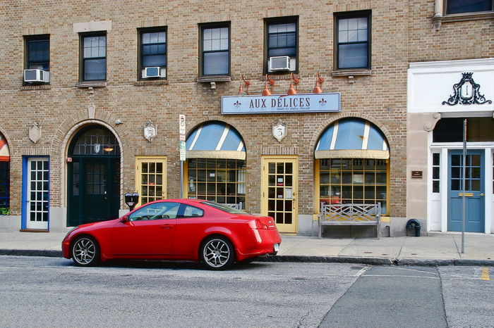 A red sports car parked in front of the famous Aux Delices Restaurant in Greenwich, Connecticut Automobile Connecticut Delices Greenwich USA Architecture Aux Building Exterior Built Structure Car City Day No People Outdoors Red Restaurant Sportscar
