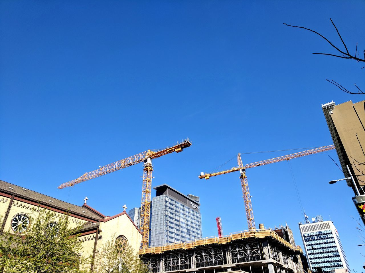 Blue Architecture Arts Culture And Entertainment Low Angle View Built Structure Sky Clear Sky Day Outdoors Building Exterior No People Construction Construction Site Construction Machinery Construction Crane Google Pixel XL