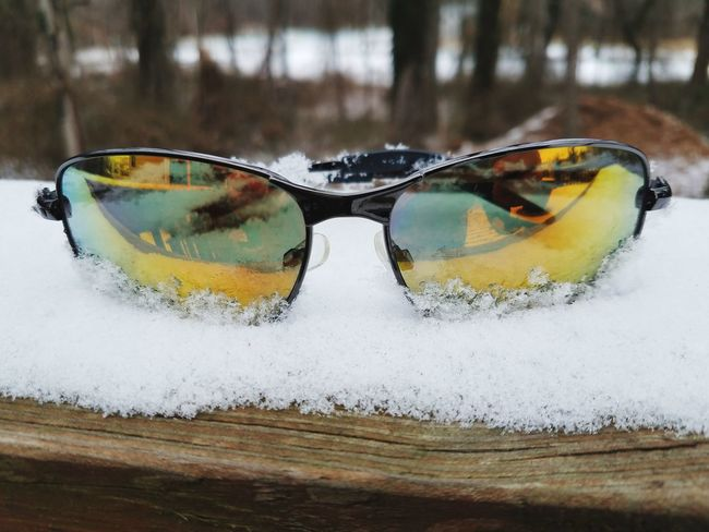 Sunglasses on top of the snow. Getting ready to escape the cold into a warmer climate for a vacation Winter Freezing Escape Vacation Ice Bitter Cold Frozen Sunglasses Reflection No People Day Water Nature Outdoors
