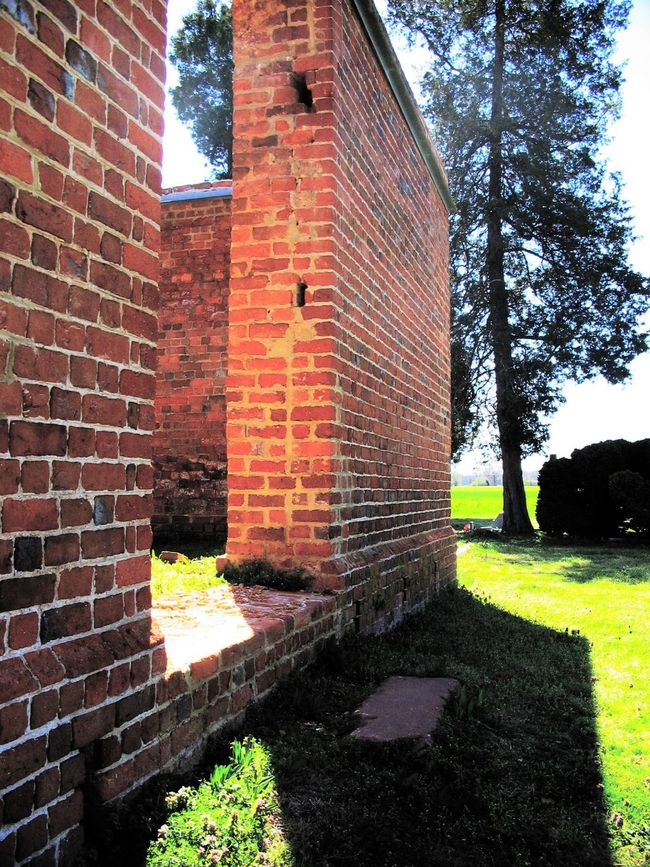 Lawnes Creek Parish Church and Cemetery, Surry County, VA Architecture Brick Wall Building Built Structure Cemetery Church Day Exterior Façade Grass Grassy Green Color Growth Historical Building Lawn Nature No People Outdoors Plant Sky Sunlight Travel Destinations Tree Tree Trunk