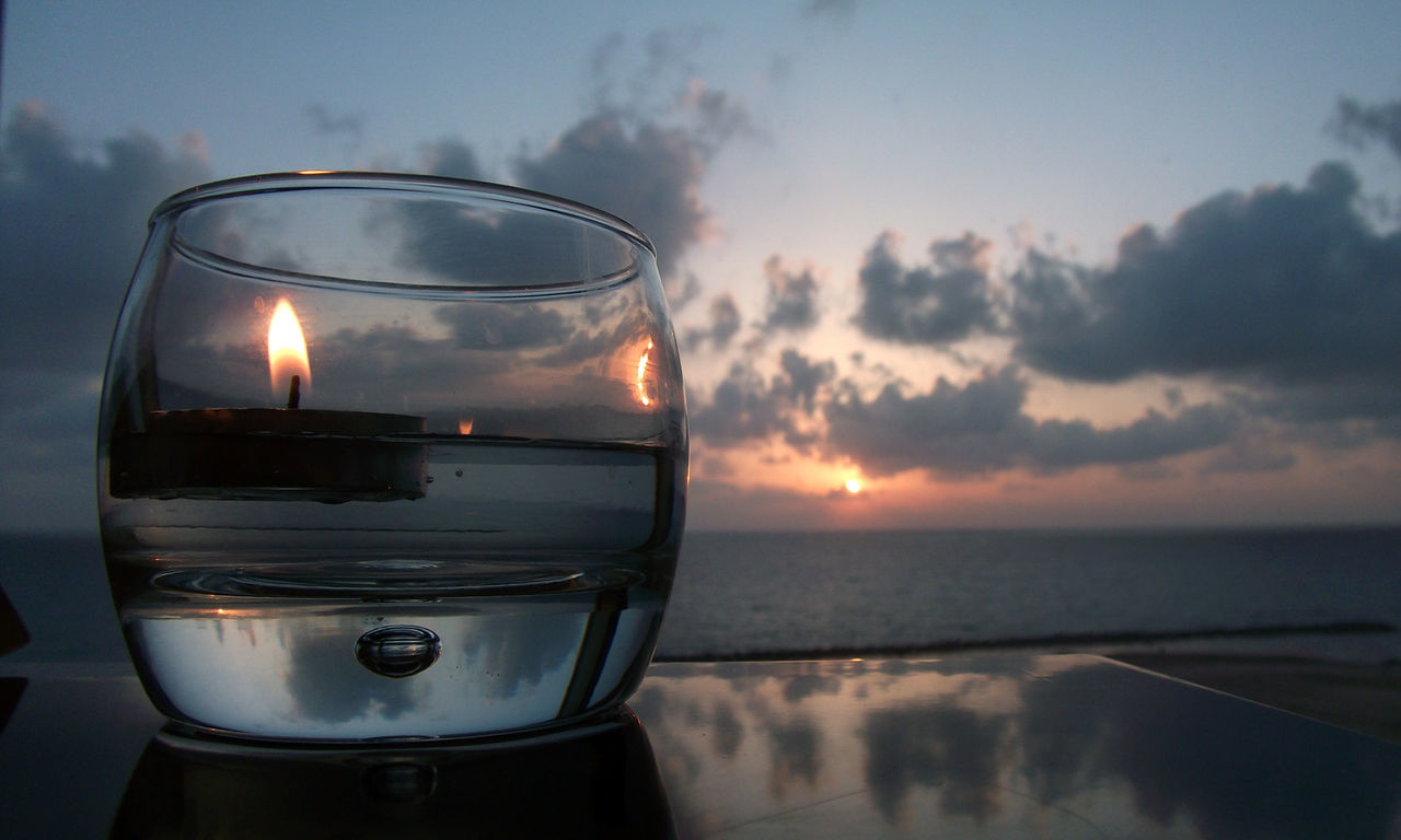 Beach Beauty In Nature Burning Close-up Drink Flame Heat - Temperature Horizon Over Water Illuminated Nature No People Outdoors Refreshment Sea Sky Sunset Tea Light Tranquility Water