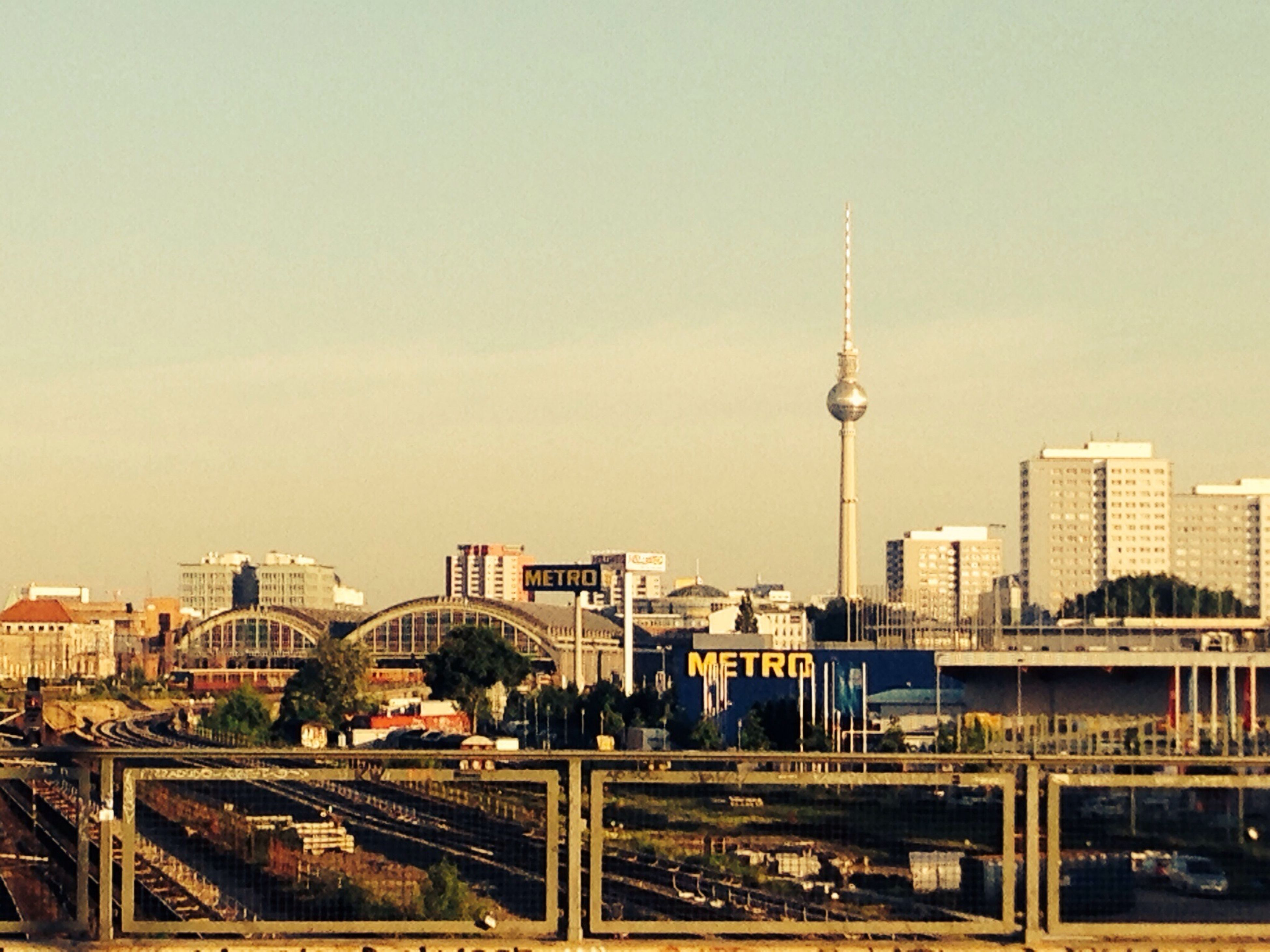architecture, built structure, communications tower, tower, building exterior, tall - high, city, international landmark, travel destinations, capital cities, famous place, communication, spire, tourism, fernsehturm, television tower, travel, skyscraper, cityscape, culture