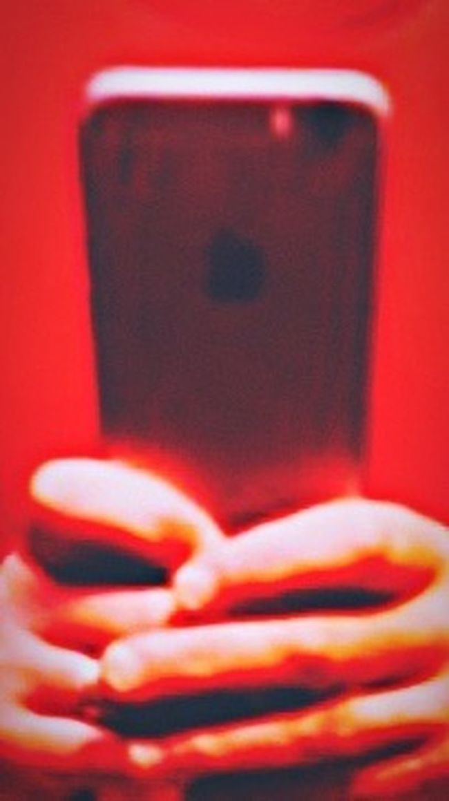 """""""Pleased to meet you, hope you guess my name."""" Internet Addiction Worshiping The IPhone IPhoneography IPhone Inward Red Hands Praying Obsessed Close-up Focus On Foreground Room For Copy Room For Text Magazine Art"""