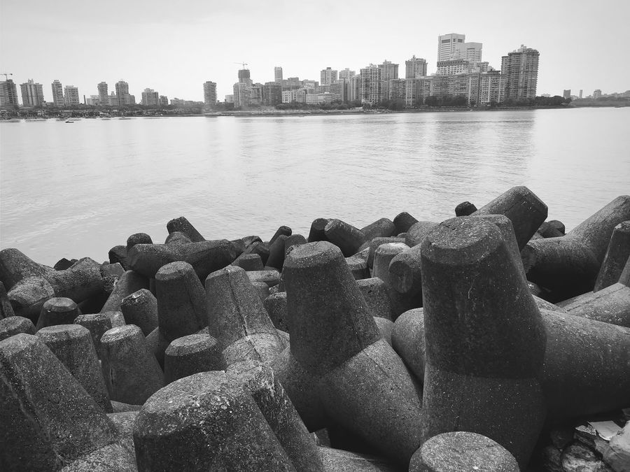 EyeEm Selects City Water Urban Skyline Skyscraper Architecture Outdoors Cityscape Beach No People Day Sky Relax Premium Collection Bnw_collection The Week On EyeEm Bestsellers 2017 EyeEm Best Shots Blackandwhite City Architecture Built Structure Mumbai Landscape India