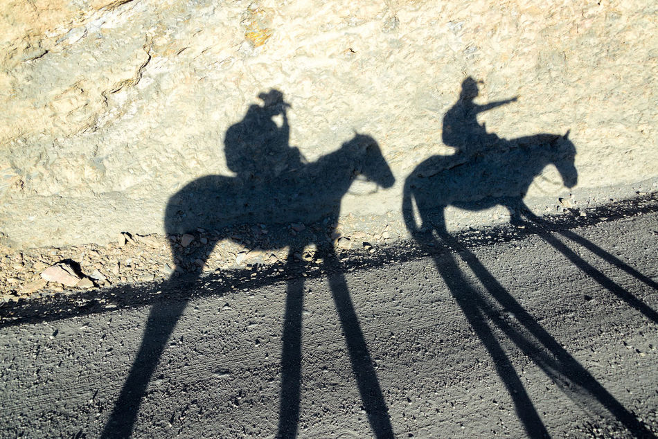 Late afternoon shadows of two horses and two riders near Tupiza, Bolivia Amazing Andes Beauty Bolivia Cactus Canyon Color Countryside Desert Destination Formation High Hills Horses Landscape Mountain Nature Point Rock Shadows Silhouette South America Travel TUPIZA Valley