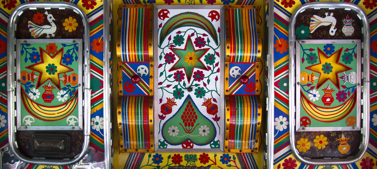 Close-up Colourful Decorative Holi India Interior Style Multi Colored No People Pattern Roof Travel Truck Vibrant