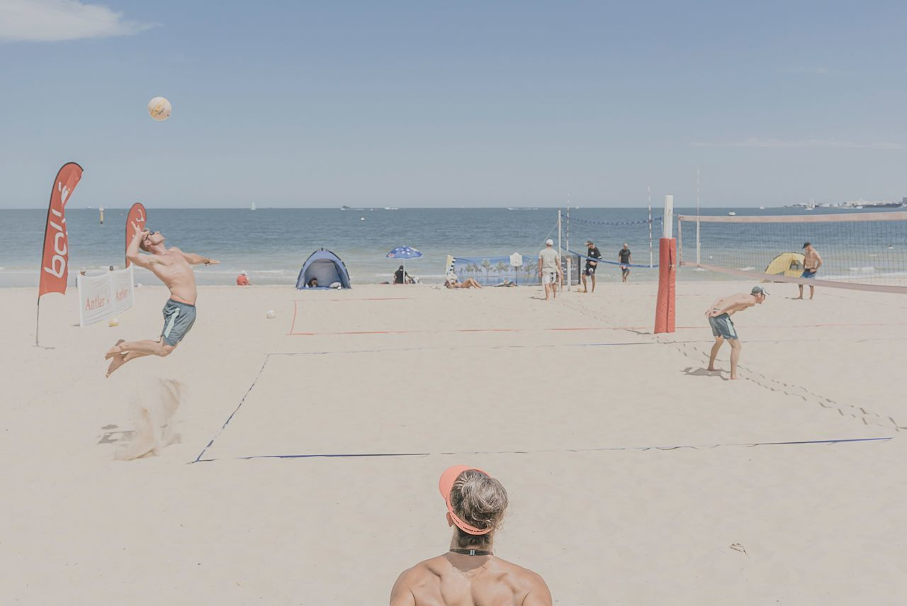 MelbournePhotographer People On The Beach People Watching Beach Sand Sea Shore Vacations Water Outdoors Day Summer Horizon Over Water Nature Volleyball - Sport Leisure Activity Fun Shirtless Beach Volleyball Sky Real People Men Large Group Of People