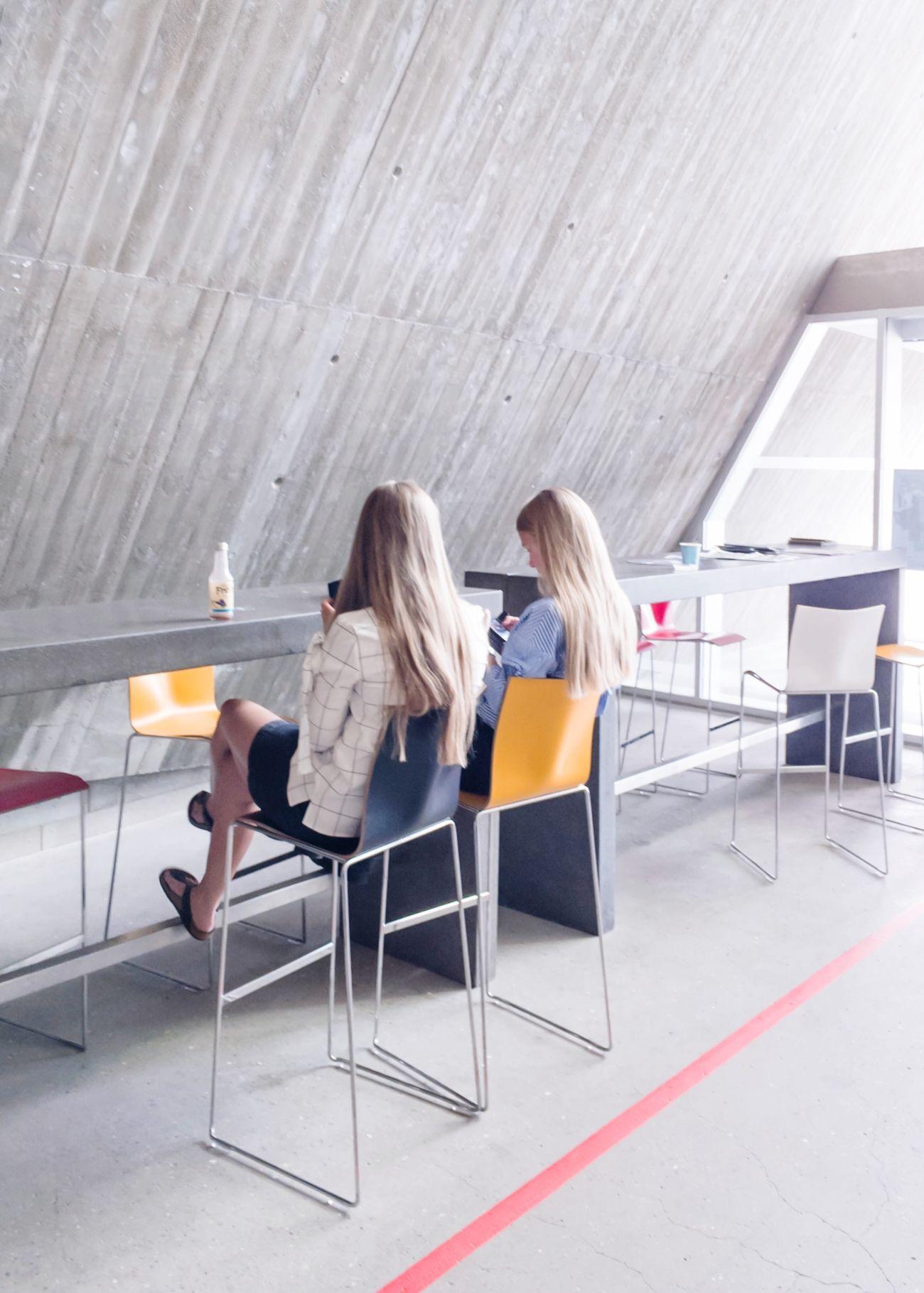 Sitting Indoors  Women Blond Hair Chair Young Women Friendship People Iphonese Concrete Interior Design Denmark
