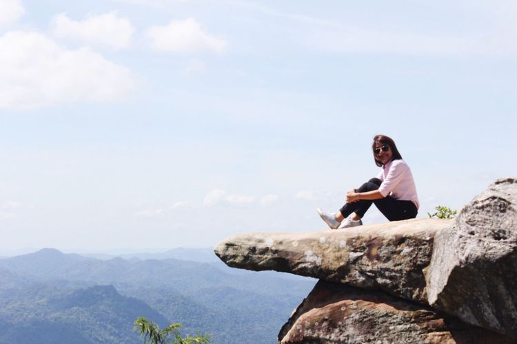 Rock - Object One Person Real People Mountain Sky Nature Cloud - Sky Full Length Beauty In Nature Lifestyles Adventure Sitting Young Women