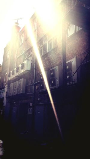 like daggers the piercing sunlight stabbed through the smog illuminating the dirty brown brickwork, transforming it into an urban sculpture Wall - Building Feature Wall Air Conditioning Units Essex Alleyway Ilford Greater London Urbanphotography Street Photography City Life Summer Views Sunbeam Sunrays Poetry Poetic