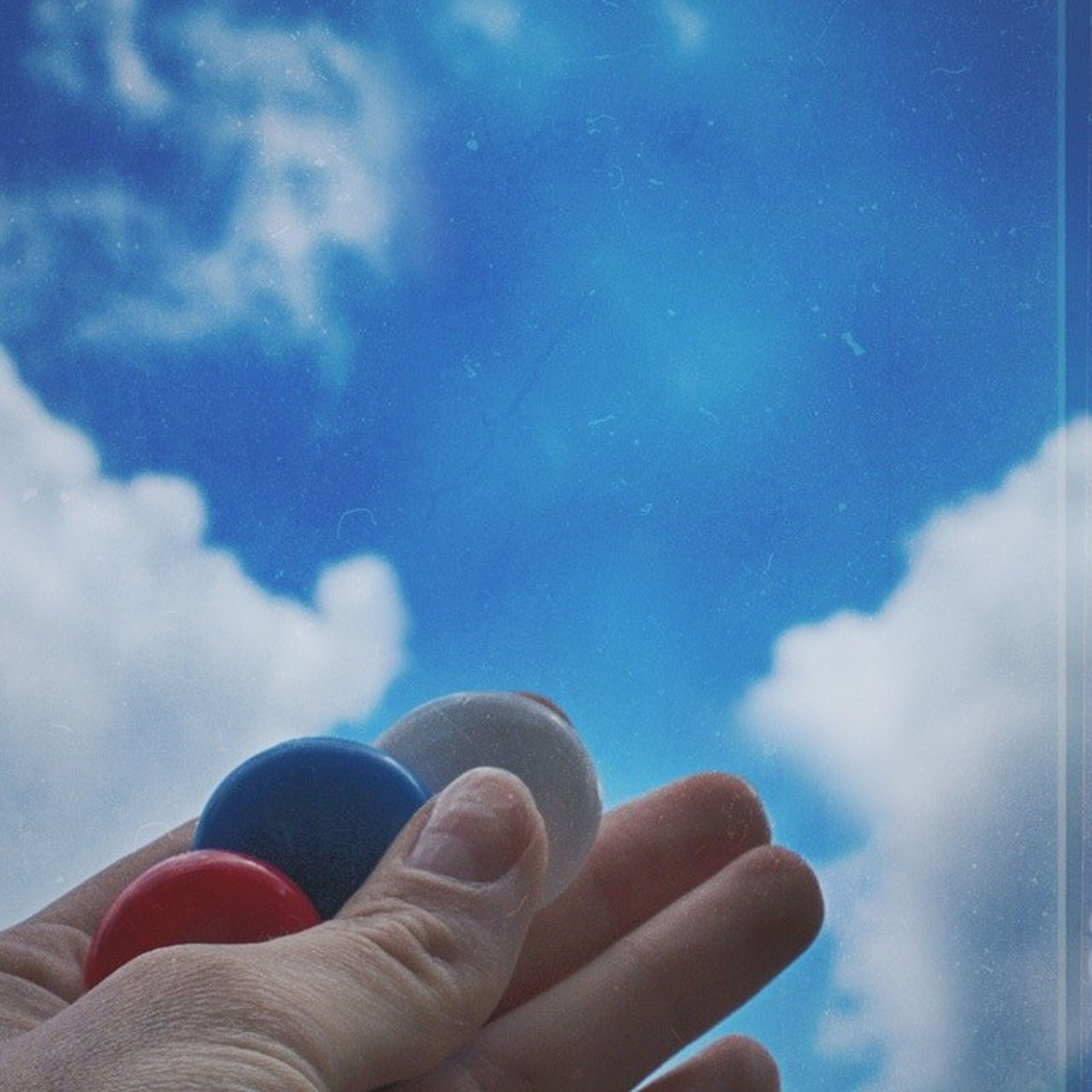 person, part of, personal perspective, sky, human finger, cloud - sky, blue, cropped, holding, unrecognizable person, low angle view, lifestyles, leisure activity, close-up, cloud, cloudy, day