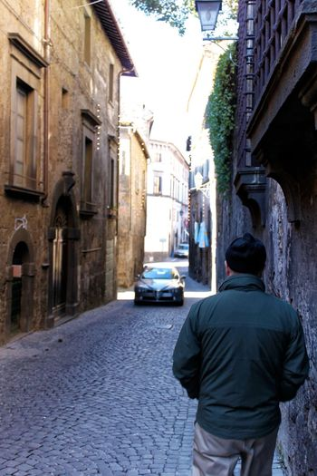 Orvieto, Italy Travel Travel Photography Traveling Architecture Building Exterior Built Structure Car City Day Italian Italy Land Vehicle Men One Person Orvieto Outdoors People Real People Rear View Residential Building Road Street Transportation Travel Destinations