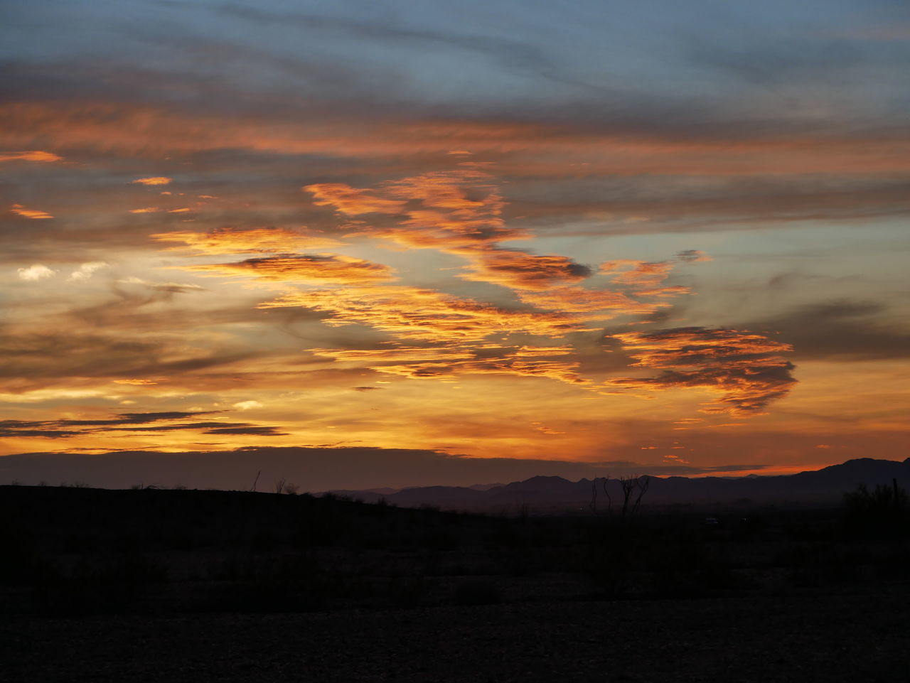 Sunset in southwest Arizona, looking west into California Arizona Arizona Desert Arizona Sky Arizona Sunsets Beauty In Nature Cloud - Sky Dramatic Sky Landscape Mountain Nature No People Outdoors Scenics Silhouette Sky Sunset