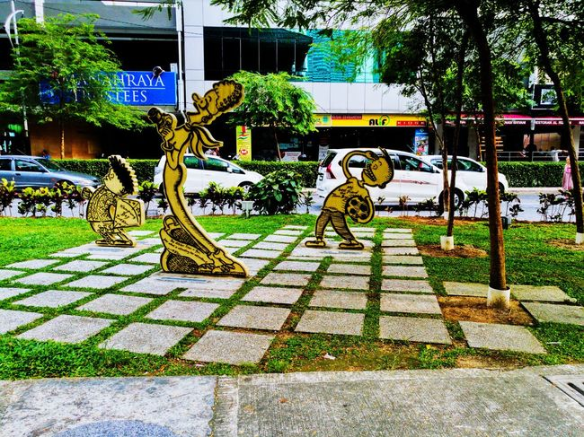 Cartoons Text Tree Outdoors Day Grass Mobilephographer Mobilephotography Leicatechnology HuaweiP9plus Huaweimobilemy Captureonp9 Huaweimobile