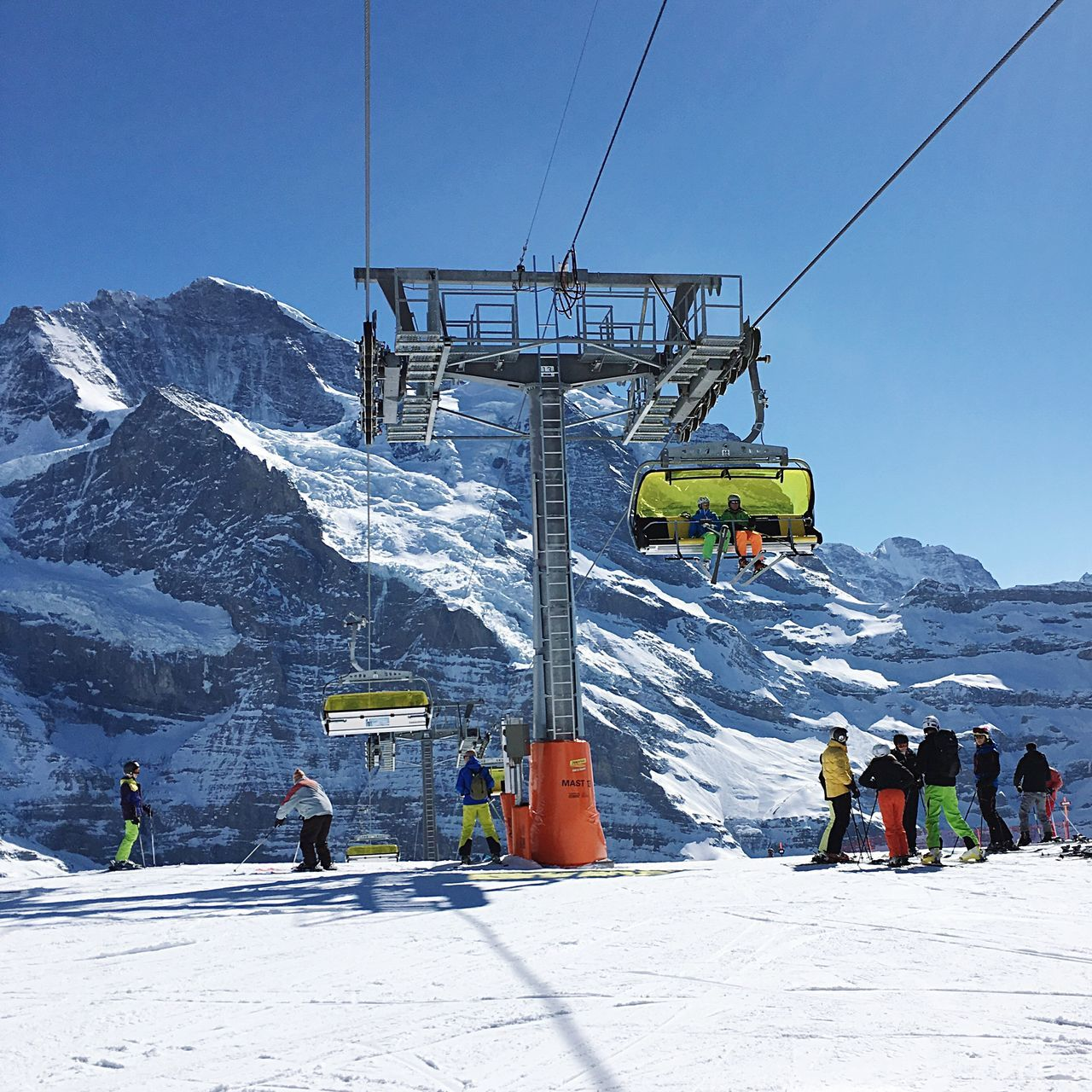 Ski lift, mountains and skiers in Wengen, Switzerland. Switzerland skiing Skiing Ski Lift Mountains Alps Holiday Wengen First Eyeem Photo
