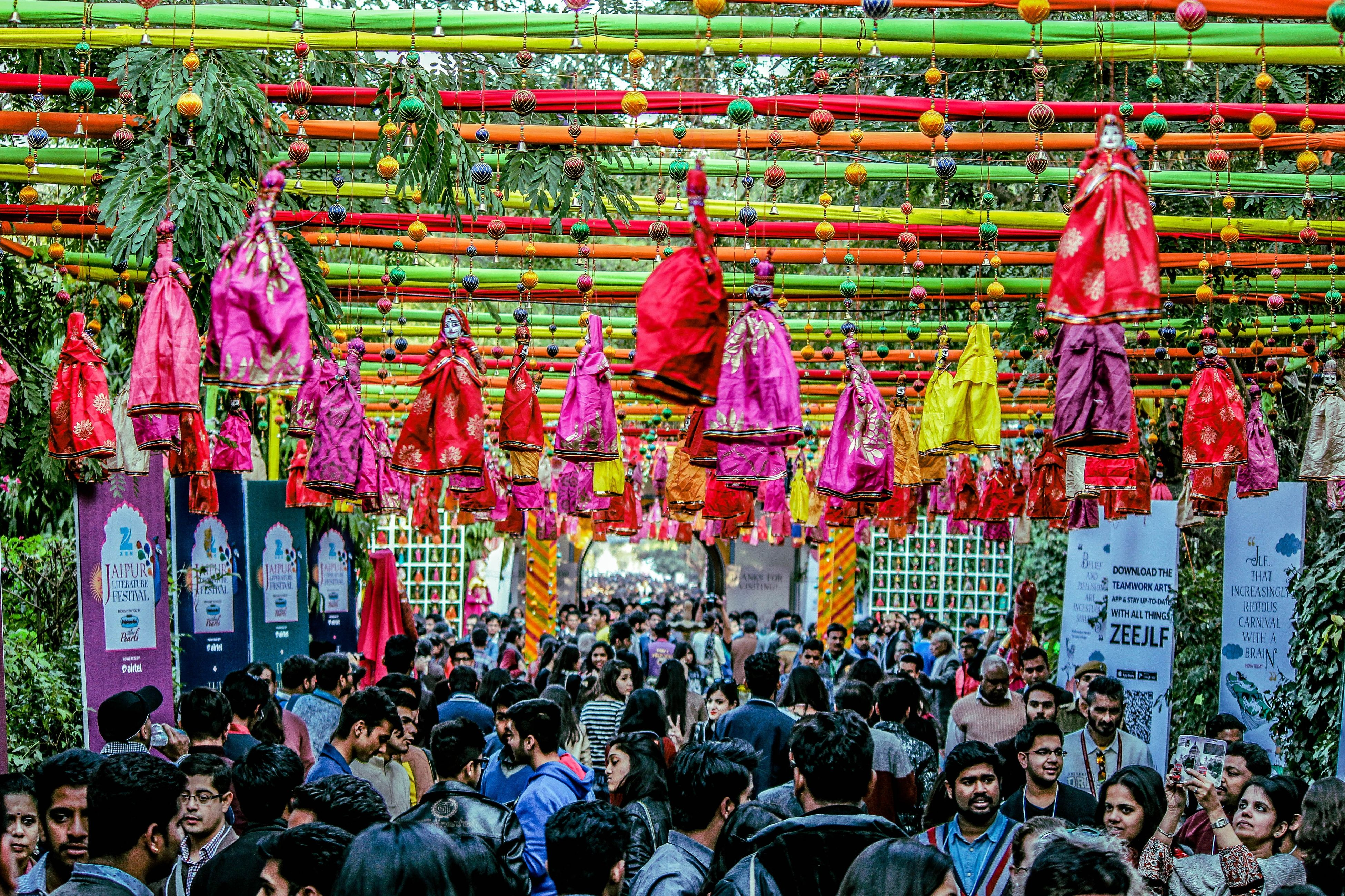 large group of people, abundance, crowd, person, men, hanging, market, retail, variation, market stall, large group of objects, for sale, lifestyles, multi colored, cultures, choice, leisure activity, in a row, street market