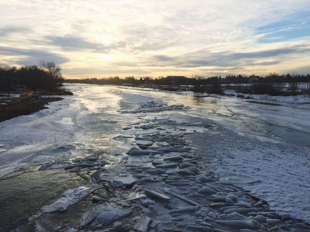 Sunrise Bow River Bridge View YYC Spring Is Coming  Frozen Water Ice Breaking Through  Riverwalk Alberta
